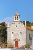 Little church in small fishing place on Mediterranean coast, Tri poster