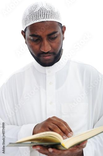 Muslim African man reading the Qoran