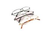 Optical glasses over white poster