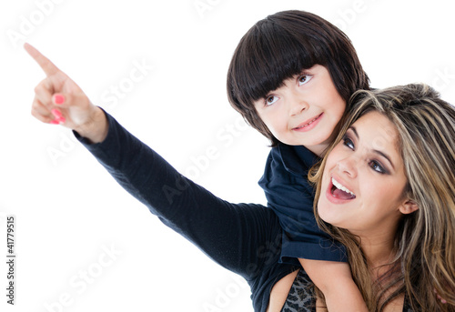 Mother pointing something to her son
