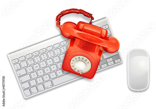 red telephone on keyboard