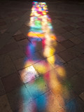 Reflection of stained glass on the stone floor in church