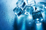 Ice cubes over wet backgrounds with back light