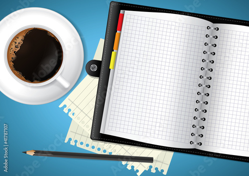 Diary and coffee on table