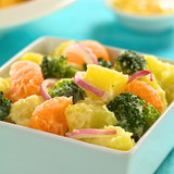 Potato, broccoli, mandarin and onion salad with mayonnaise