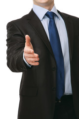 A businessman giving his hand for a handshake, focus on his hand