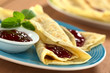 Fresh homemade crepes filled with strawberry jam