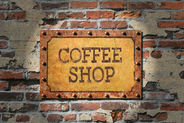 Rusted Coffee Sign on 1890's Brick Wall