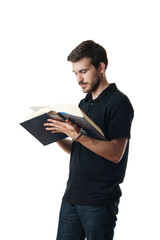 Man reading from a large book