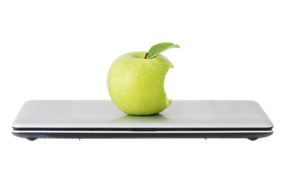 green apple in a closed laptop