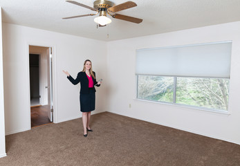 Young female real estate agent showing an empty home