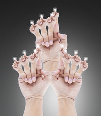 group of  people's hands isolated on gray background