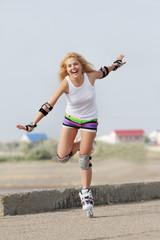 young happy woman enjoying rollerblading / roller skating