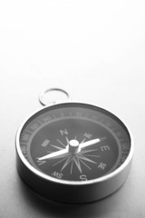 Compass on a gray gradient background, place for text