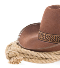 brown cowboy hat and rope isolated on white