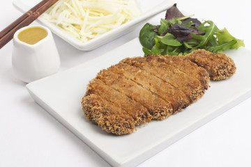 Tonkatsu served with shredded cabbage and curry sauce