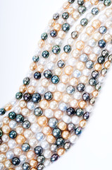 color pearls on white background, realistic