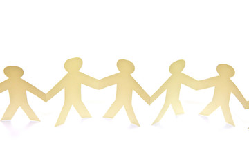 Cutout paper people over white background