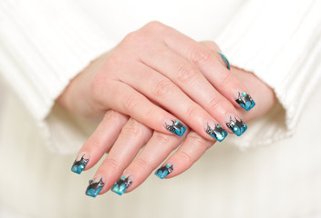 Female hands with blue manicure