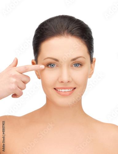 beautiful woman pointing to eye