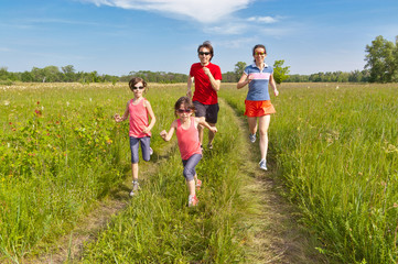 Family sport, jogging. Happy active parents with kids run