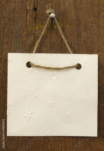 blank paper note hanging