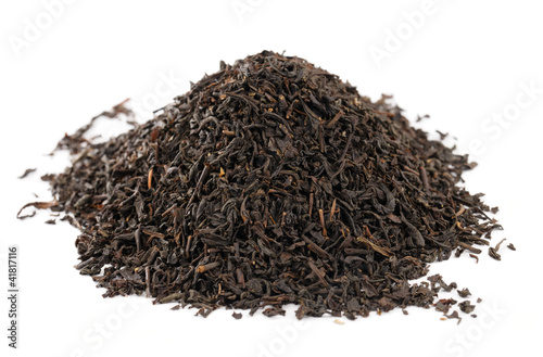 Earl Grey  black loose tea leaves on white background, shallow d