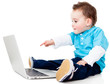 Boy pointing at a laptop