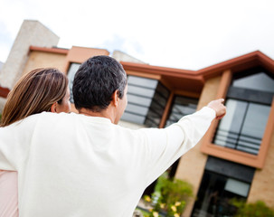 Couple pointing at their dream home