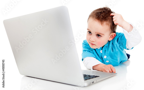 Confused boy with a computer