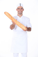 A baker showing off his bread