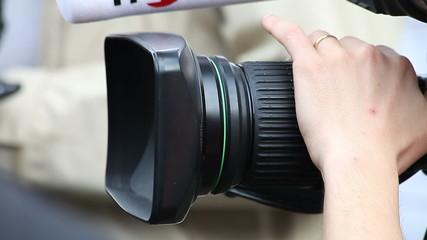 Cameraman with camera (close up)