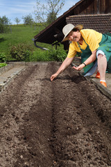 Retired woman planting seeds