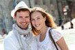 Smiling couple visiting French city in summertime