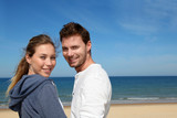 Portrait of happy couple at the beach