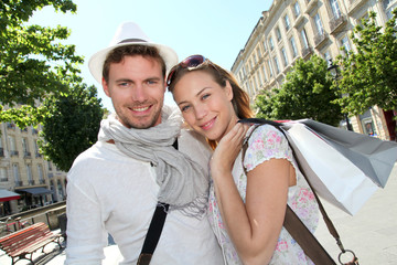 Smiling couple doing shopping in Bordeaux
