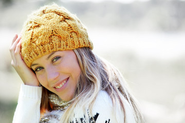 Portrait of blond woman in winter clothes and accessories