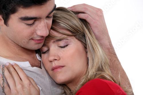 Man comforting his girlfriend