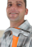 Close-up of man holding hammer