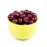 Cherry in green plastic bowl isolated on white background