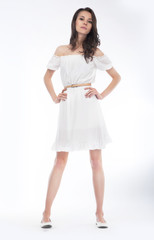 Beautiful woman with elegant white dress. Fashion
