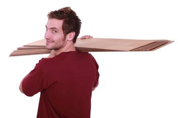 Man carrying parquet slats