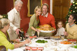 Family having Christmas dinner, portrait of couple with turkey