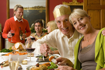 Family having Christmas dinner, portrait of senior couple