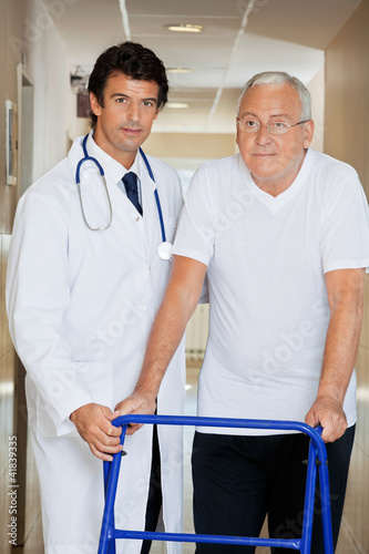 Doctor Helping An Old Man With His Walker