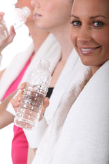 Women drinking water after an exercise class