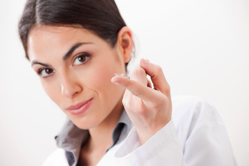 Female Optometrist With Contact Lens