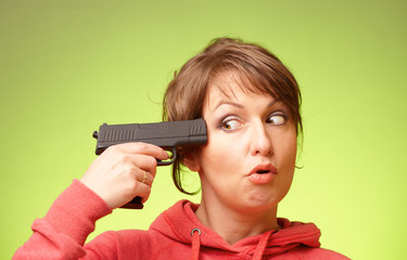 Woman with pistol pointing on her head