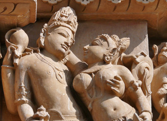 Vishnu and Lakshmi embracing in Hindu temple sculpture