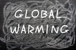 """Global Warming"" written on a chalkboard"